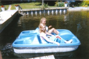 Mom and I in a paddle boat on Lake Martha in Washington.