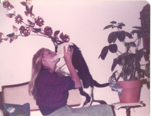 Sharon cuddling with a cat.